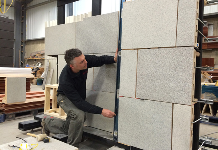 Craig Cudney, Boston Valley's Quality Control Manager, checks tolerances of the mock up as it is constructed at Boston Valley.