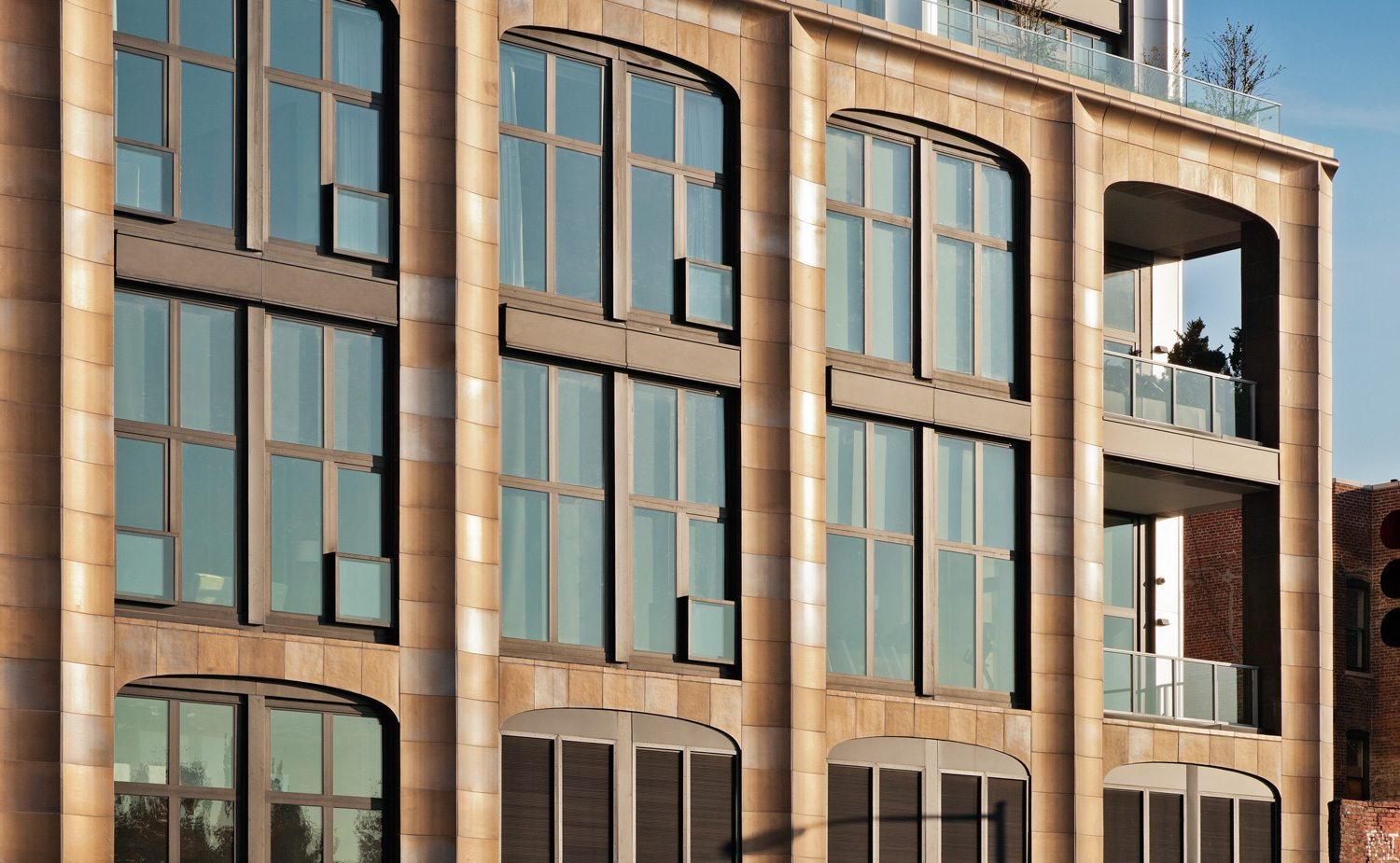 200 Eleventh Avenue in New York City, a new build architectural terra cotta masonry facade with a custom copper glaze. Designed by Selldorf Architects.