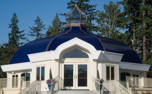 The Ananda Church in Bothell, Washington, Hand pressed and RAM pressed architectural terra cotta roof tiles glazed in a rich blue hue.