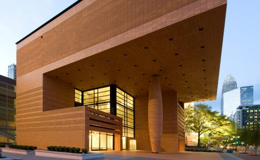 An night view of The Bechtler Museum of Modern Art in Charlotte, NC covered in Boston Valley Terra Cotta's TerraClad Rainscreen system.