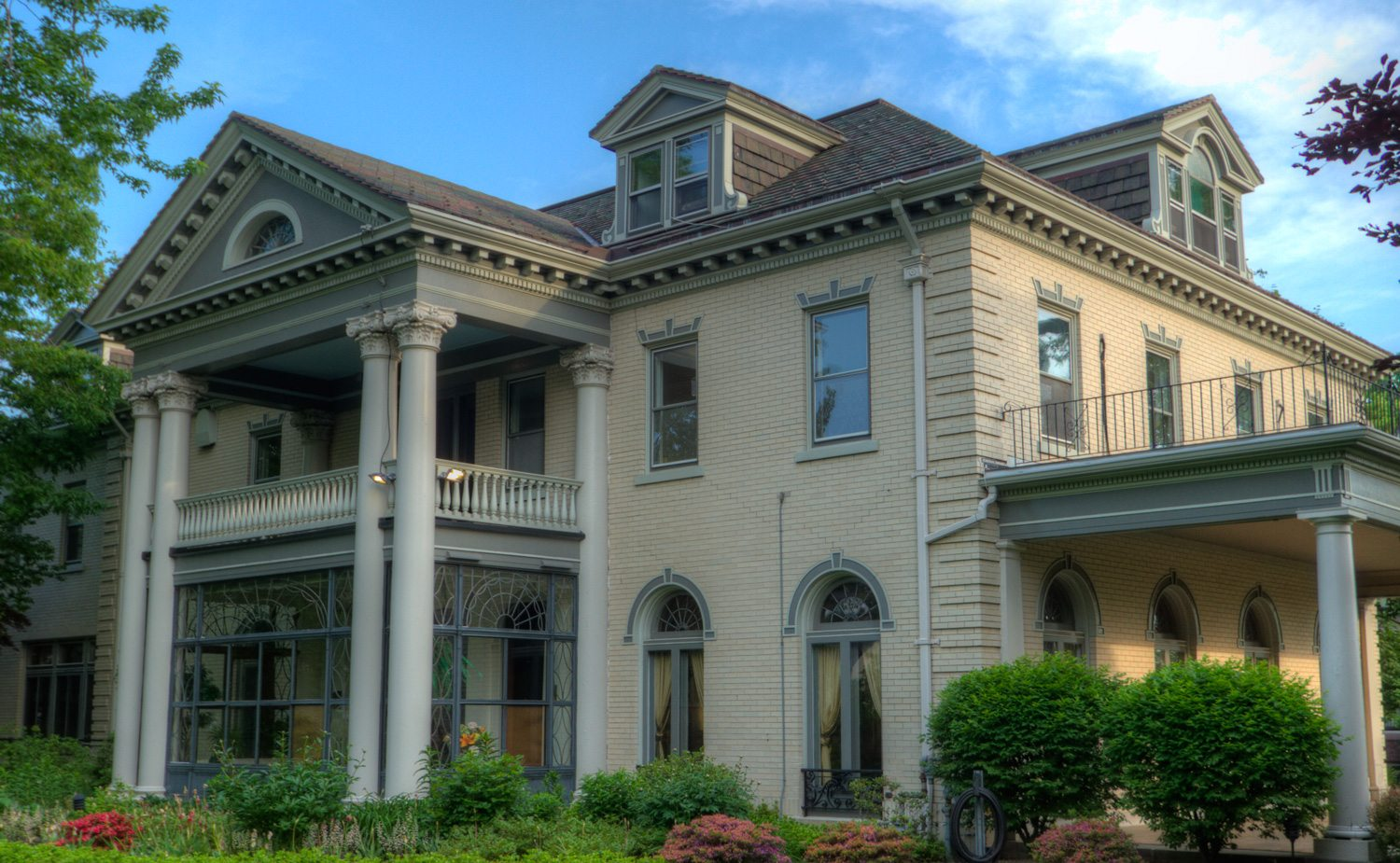 Buffalo State College President's House in Buffalo, NY. Hand and RAM pressed architectural terra cotta roof tiles manufactured by Boston Valley Terra Cotta.
