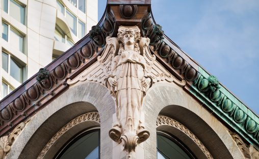 Detail shot of 150 Nassau in New York City an architectural terra cotta restoration that utilized 3D CAD/CAM technology to recreate the angels named Dorthy that flank the top corners of the building.