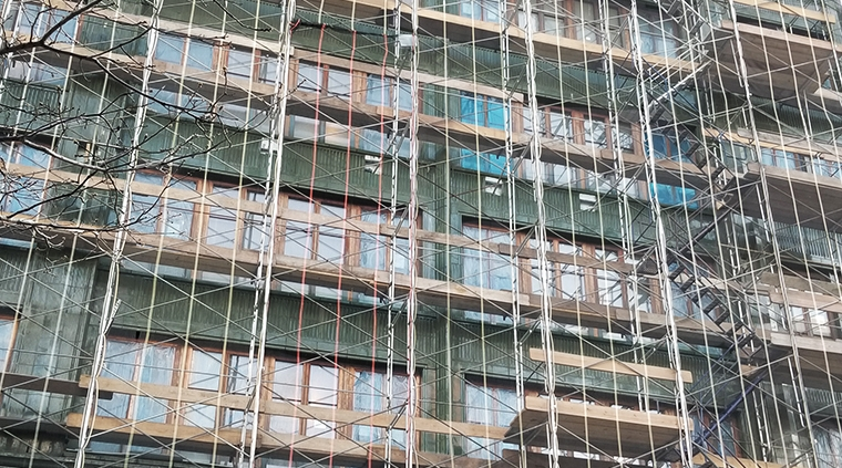 Scaffolding in front of The Fitzroy, 514 West 24th street in New York City. A new residential building by JDS Development, designed by Roman and Williams with a green terra cotta façade by Boston Valley Terra Cotta
