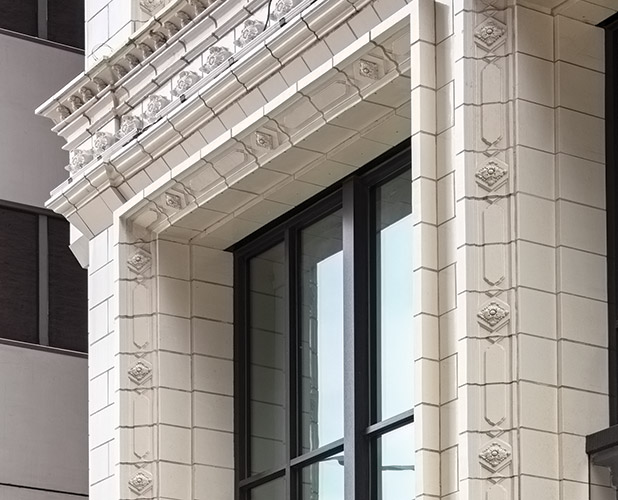 A portion of the entryway at 168 North Michigan Avenue, Chicago IL, the restoration features terra cotta masonry by Boston Valley Terra Cotta
