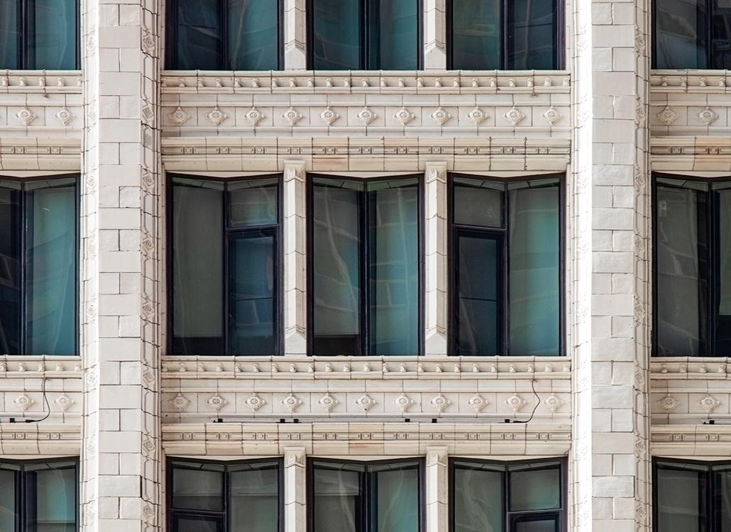 A close up of the white glazed terra cotta masonry on 168 North Michigan Avenue in Chicago, IL