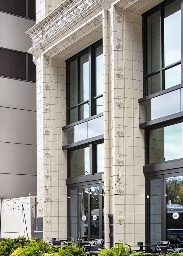 The entrance of 168 North Michigan Avenue, Chicago IL, the restoration features terra cotta masonry by Boston Valley terra Cotta