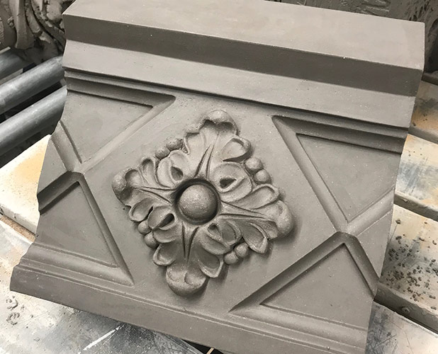 An unfinished piece of the terra cotta masonry used for the restoration of 168 North Michigan Avenue; Boston Valley used all four forming methods in production