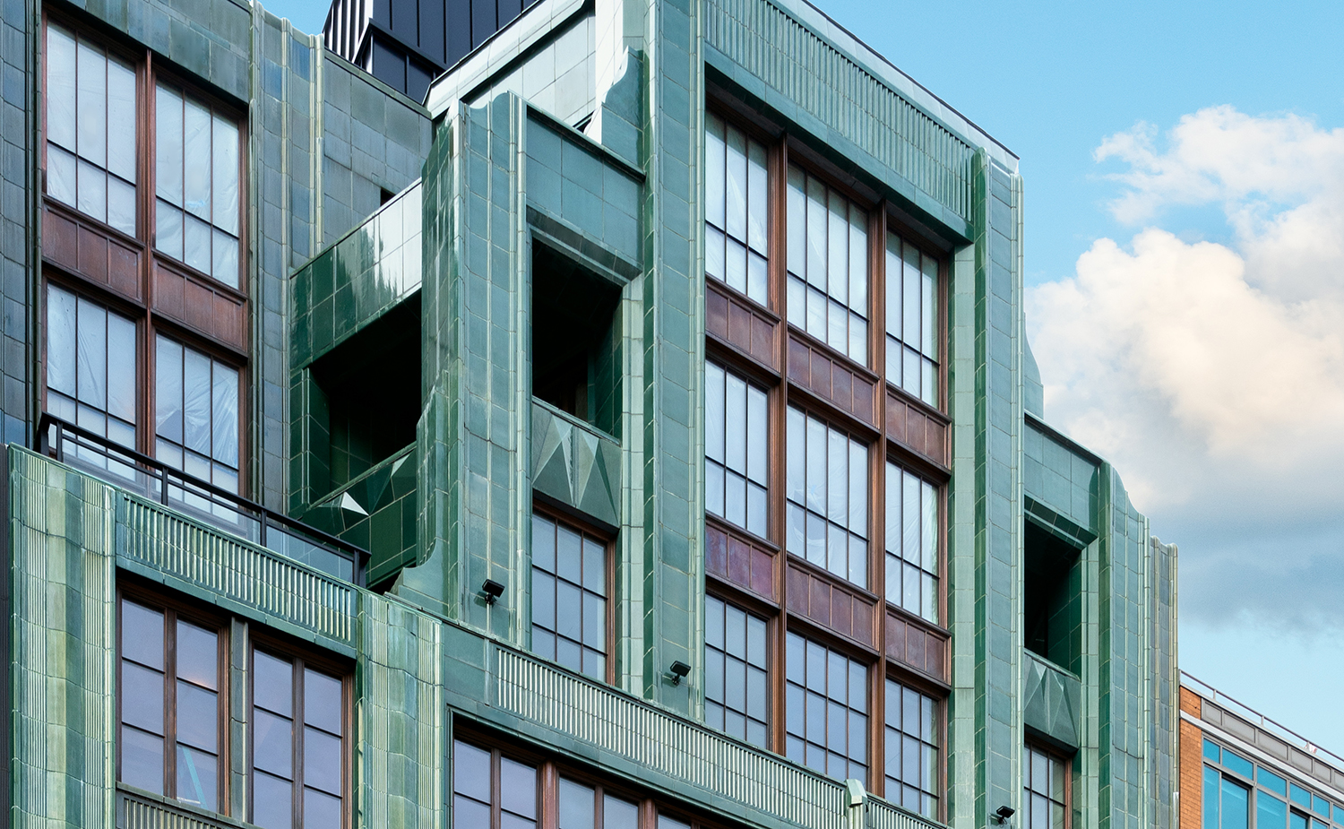 The Fitzroy in NYC is a new residential building by Roman and Williams with signature green glazed terra cotta masonry manufactured by Boston Valley Terra Cotta