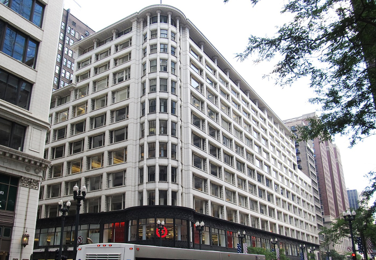 Louis Sullivan, Sullivan Center, Chicago Illinois is clad in white terra cotta masonry.