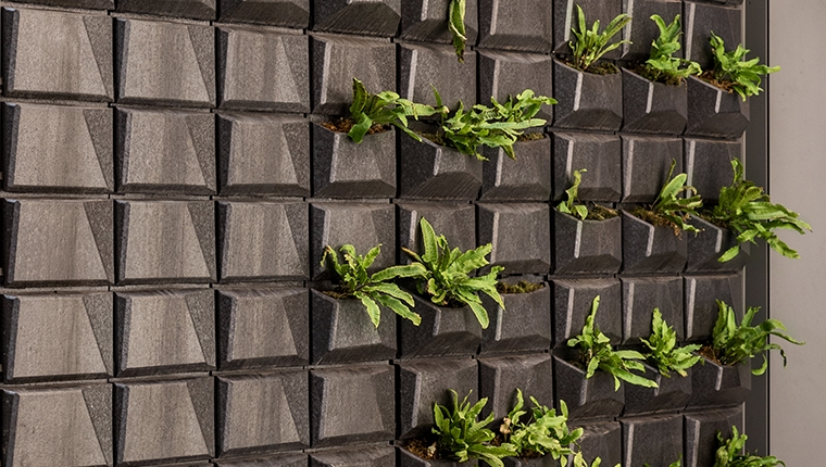 The green wall at Michael Chen's NYC Townhohuse was developed to hold native plants inside. Boston Valley manufactured the terraclad wall and planters for the project.