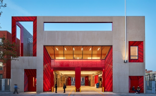FDNY Rescue Company 2 training facility in Brooklyn, NY designed by Studio Gang, the firetruck entrance bordered by vibrant red TerraClad terra cotta panels