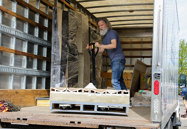 Andy Brayman at the 2019 Architectural Ceramic Assemblies Workshop unloading prototypes for the final presentation.
