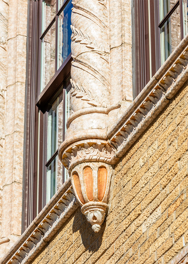 A close look at a finial detail on the Capitol Theatre in Flint, MI, with terra cotta masonry restoration completed by Boston Valley and Grunwell-Cashero