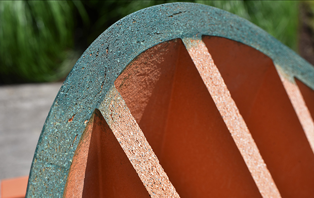 detail shot of a terra cotta block with a painted edge