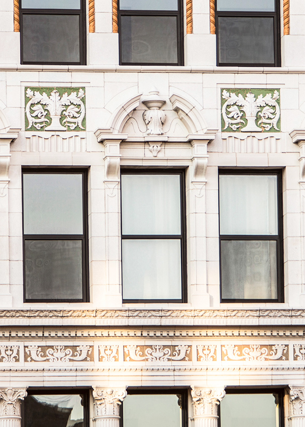 A closer look at the green and gold terra cotta masonry detailing on the restored Wurlitzer Building in Detroit, MI, manufactured by Boston Valley Terra Cotta