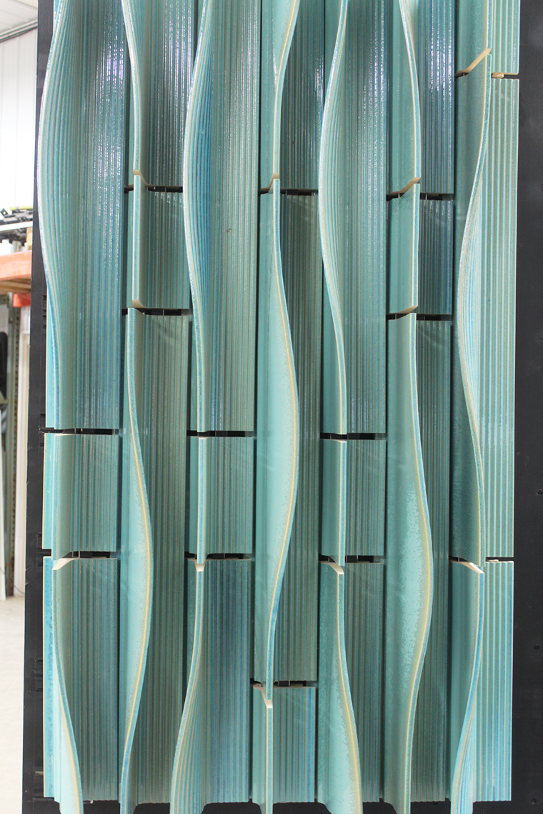 The terra cotta fins of Pelli Clarke Pelli and Studios Architecture prototype was manipulated during its wet state to create curved forms.
